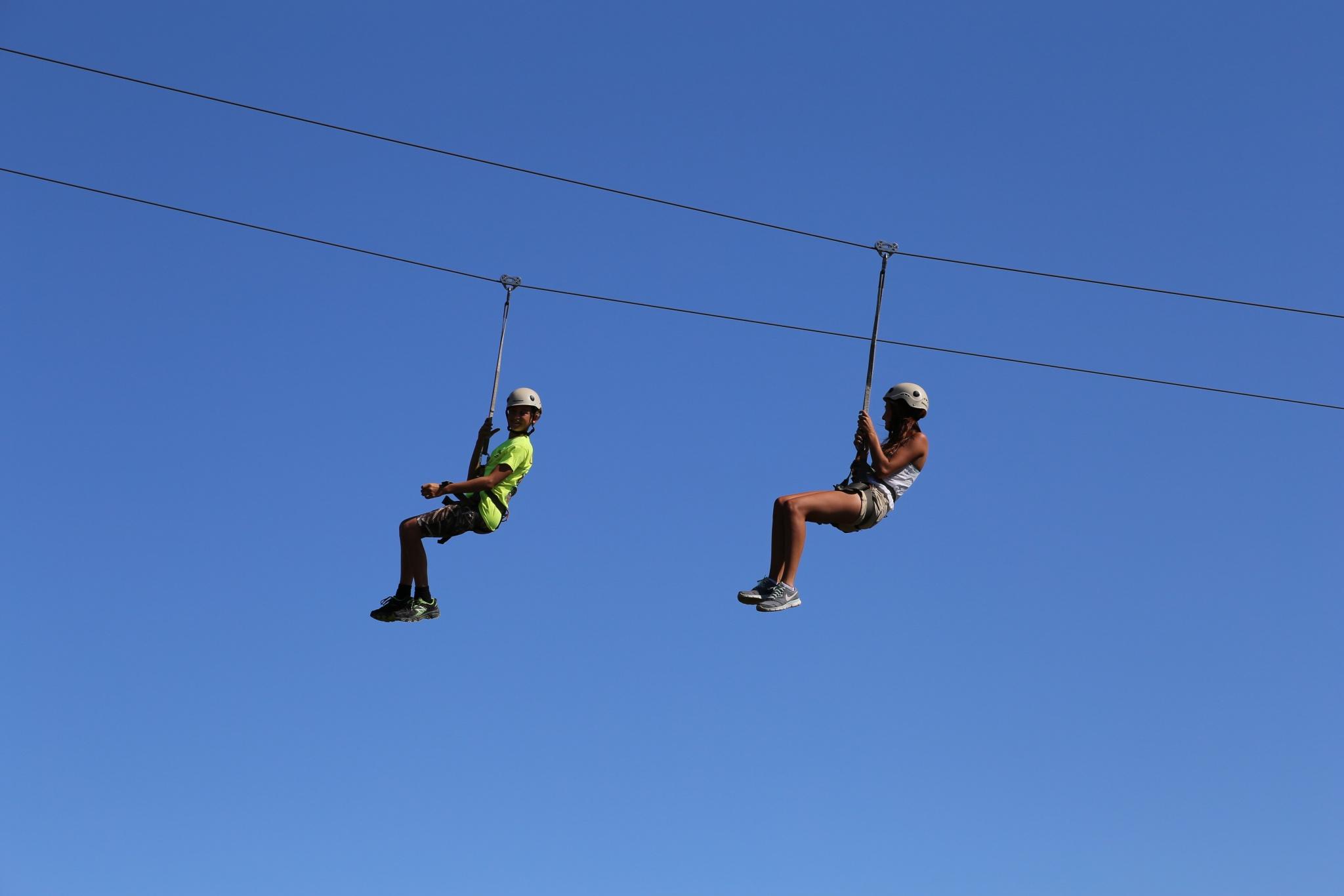 two adults on a zipline