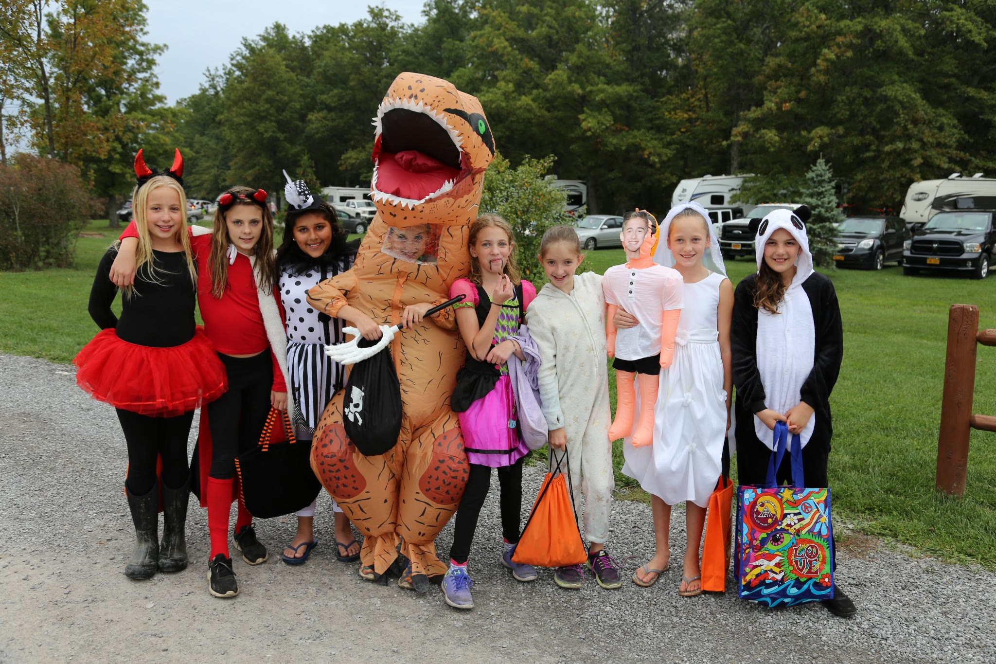 little girls trick-or-treating in various costumes