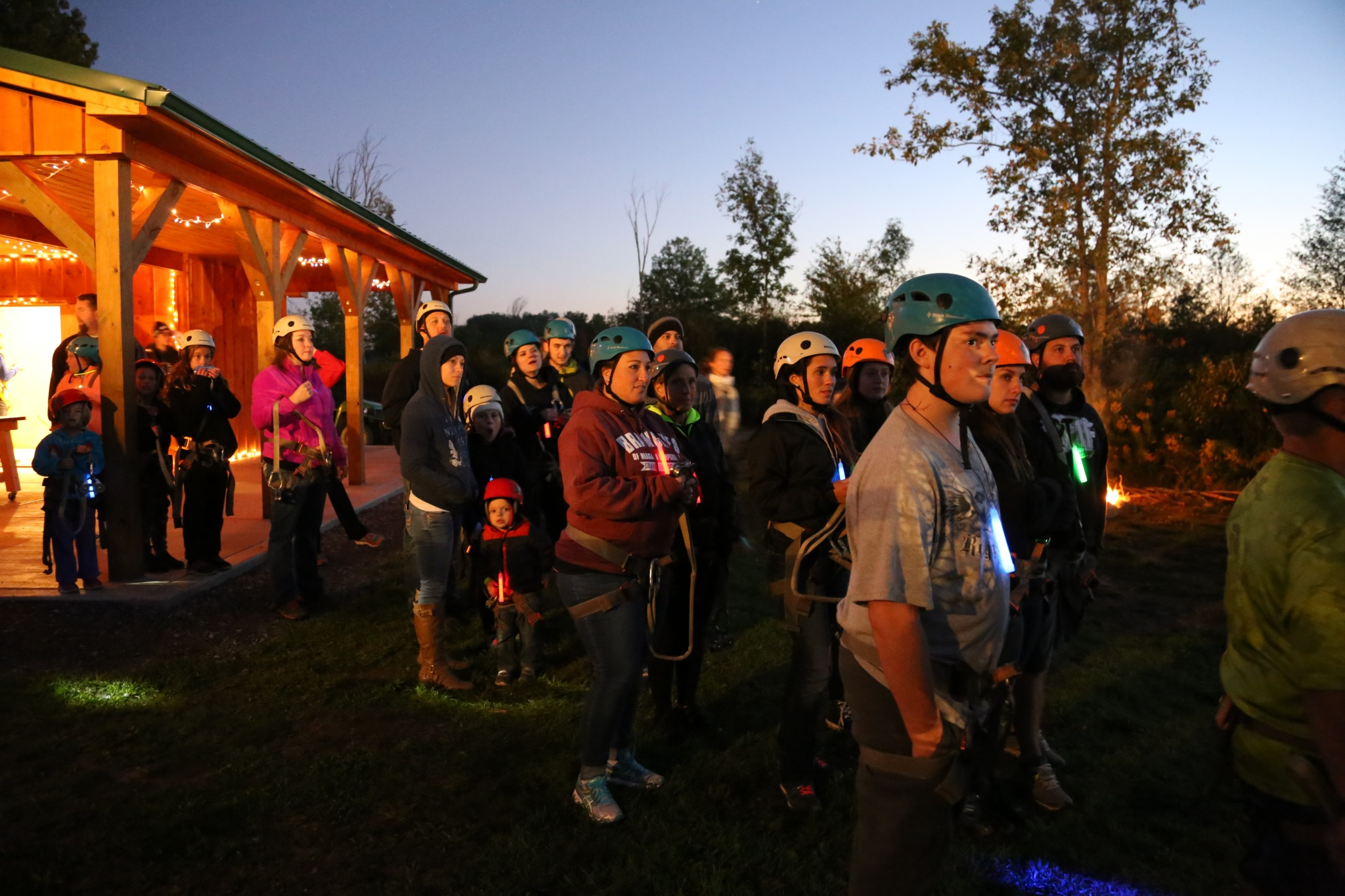 kids geared up for ziplining at night