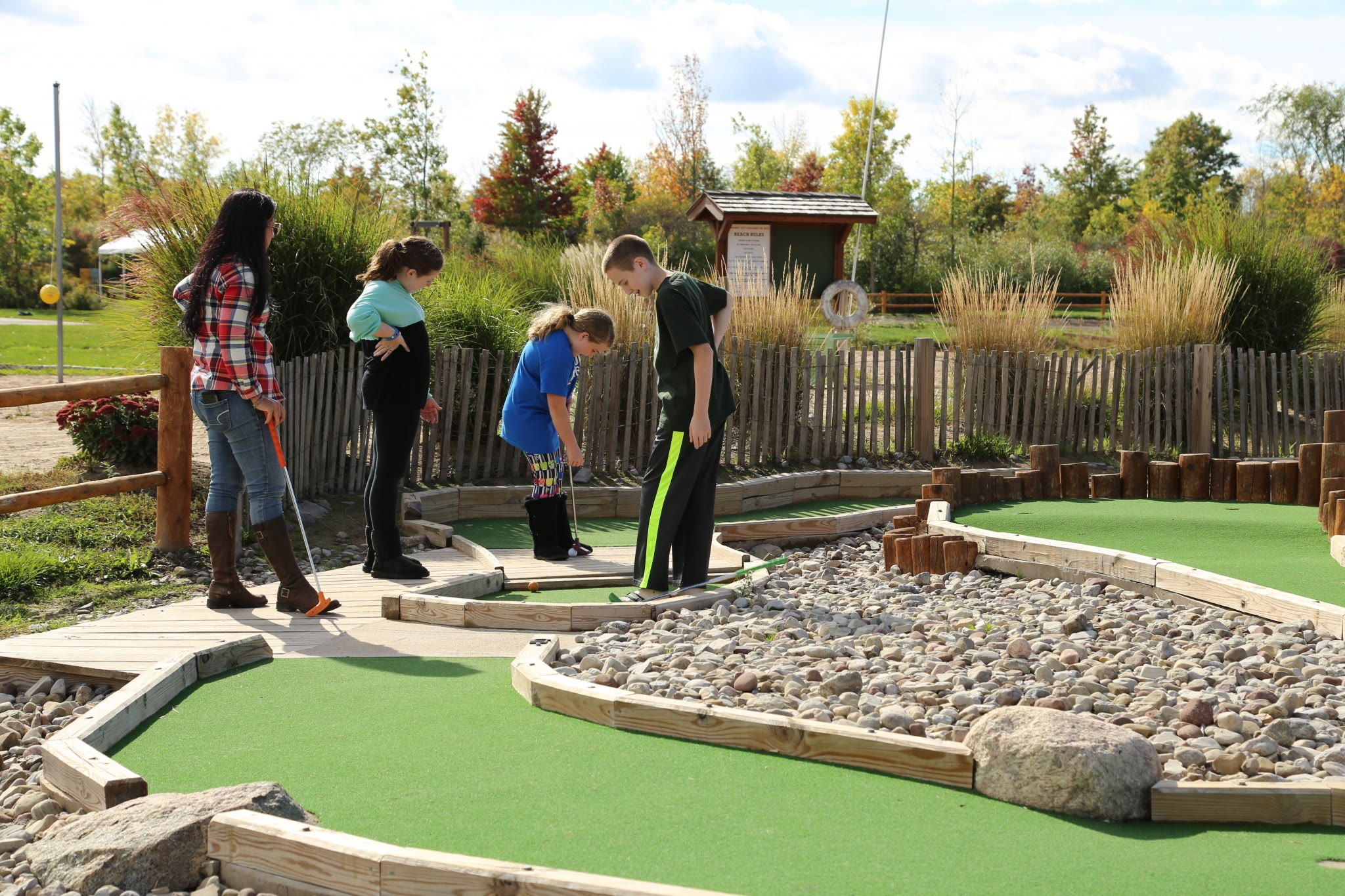 people playing mini golf