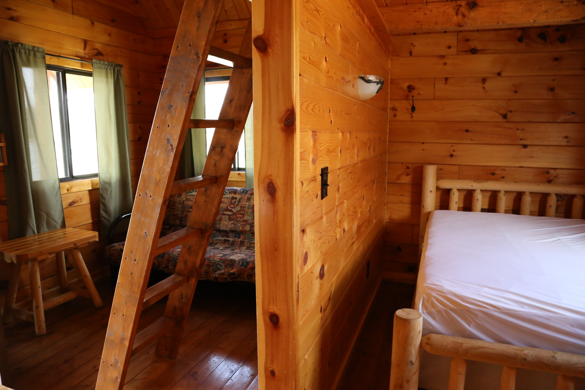 standard cabin interior - wooden wall with a wooden ladder to the loft