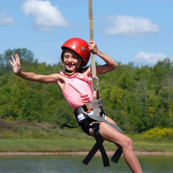 little girl on a zipline