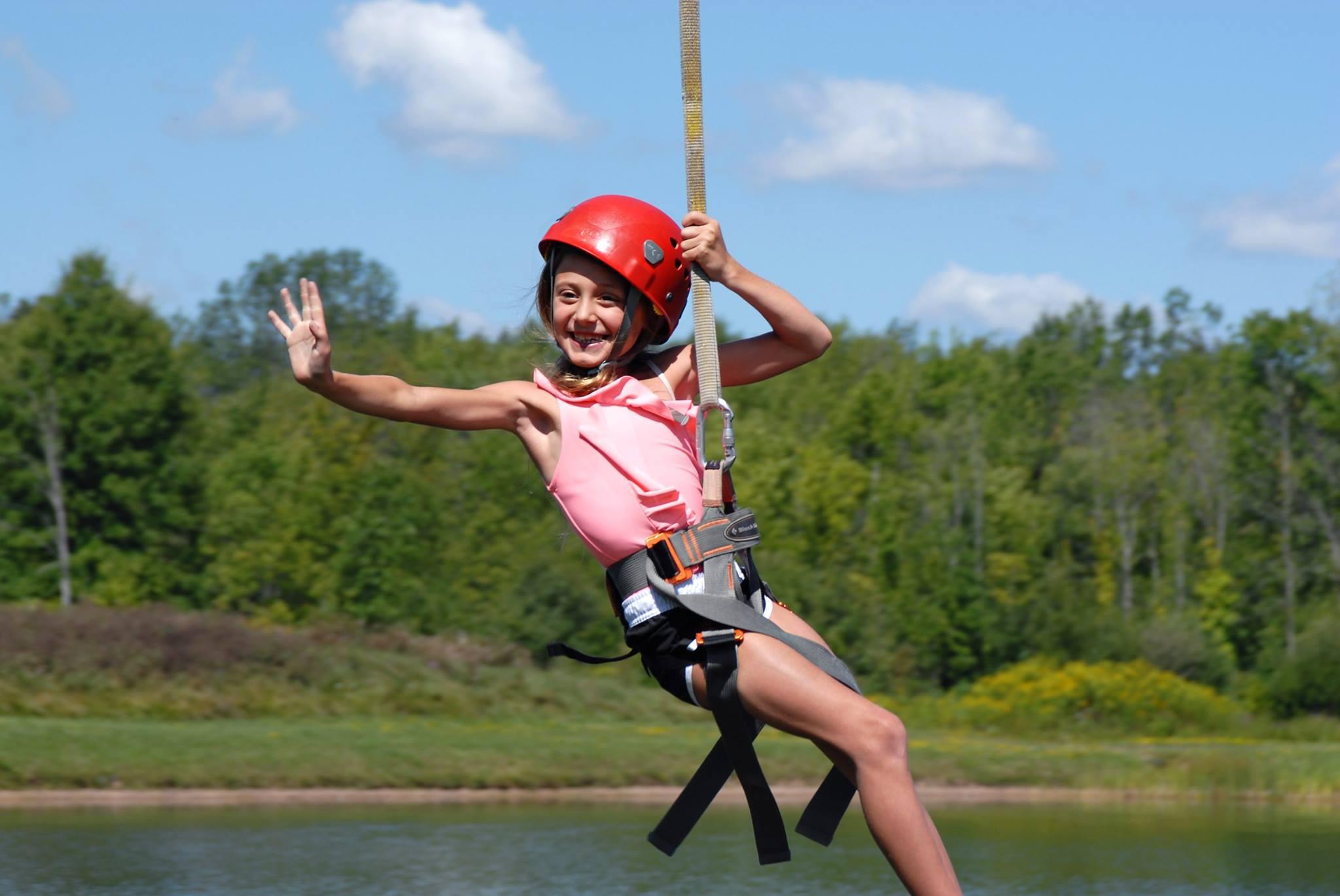 little girl on a zipline