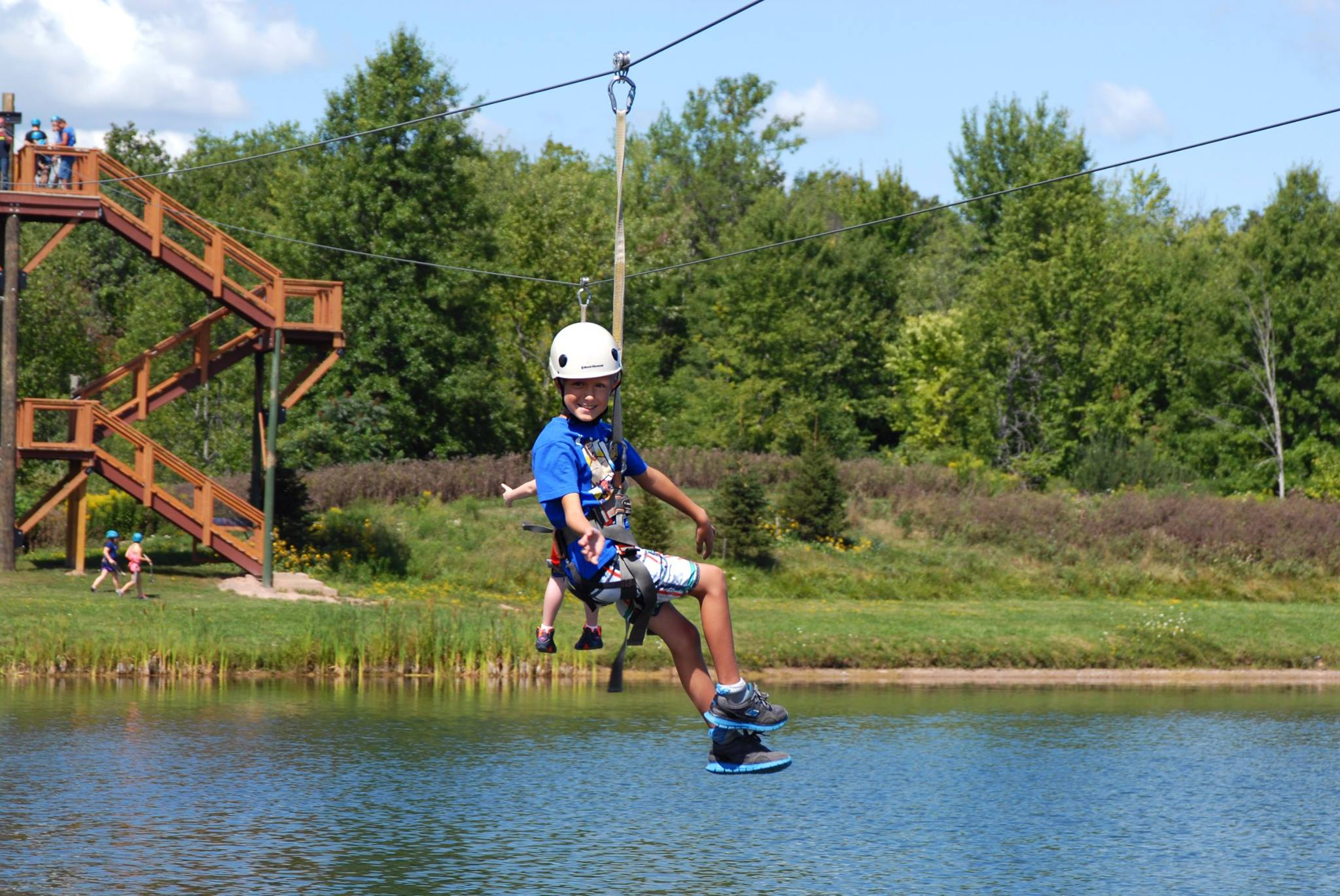 little boy on a zipline