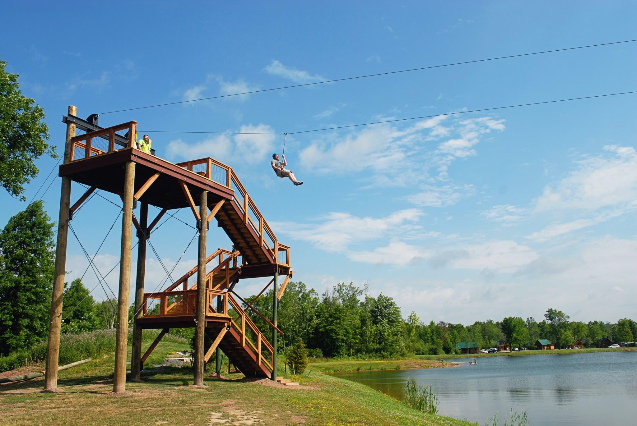 person descending on a zipline