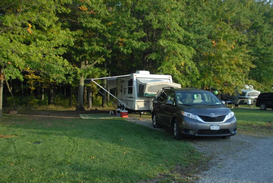 small trailer and mini van on campsite