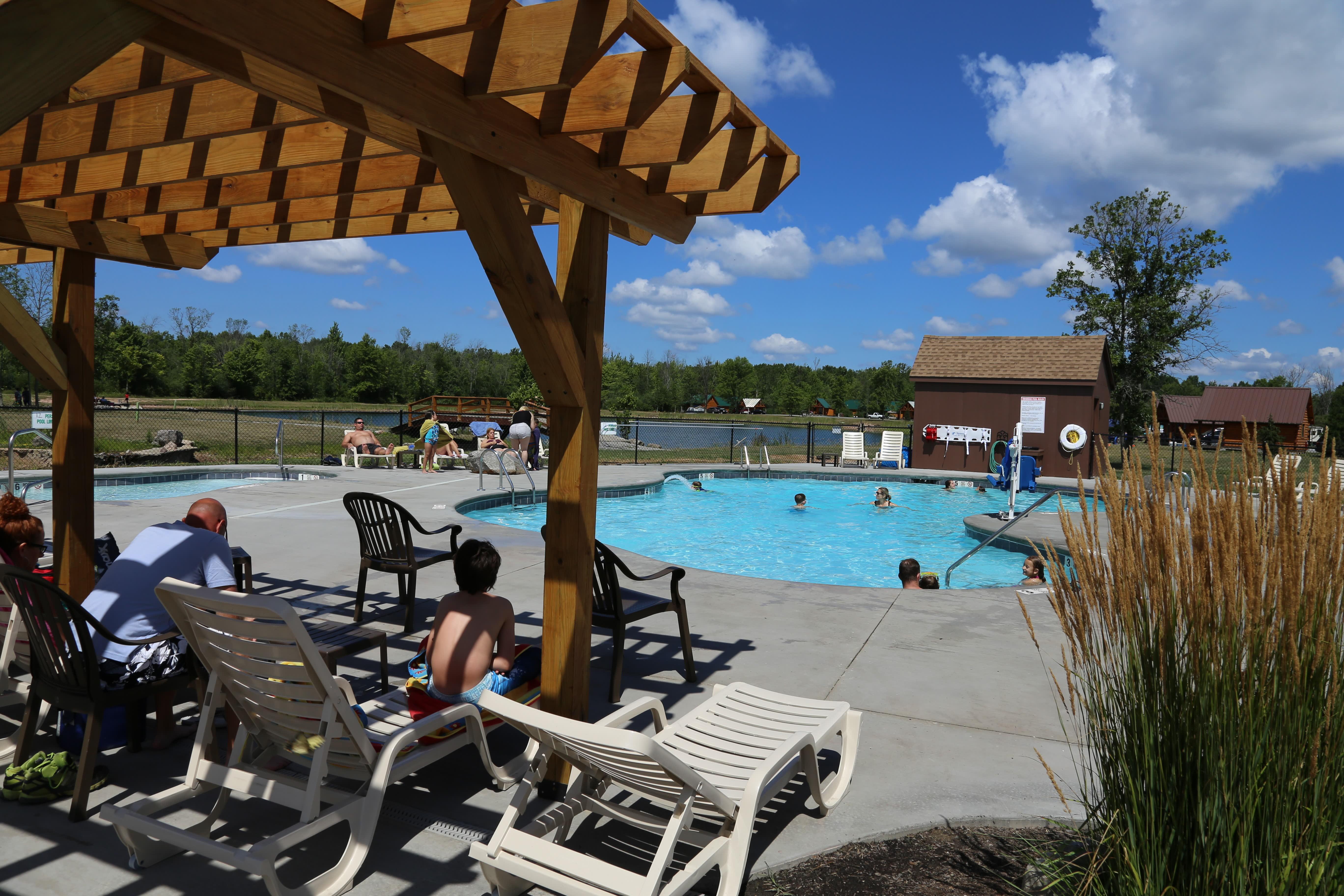 swimming pool with shade pergola