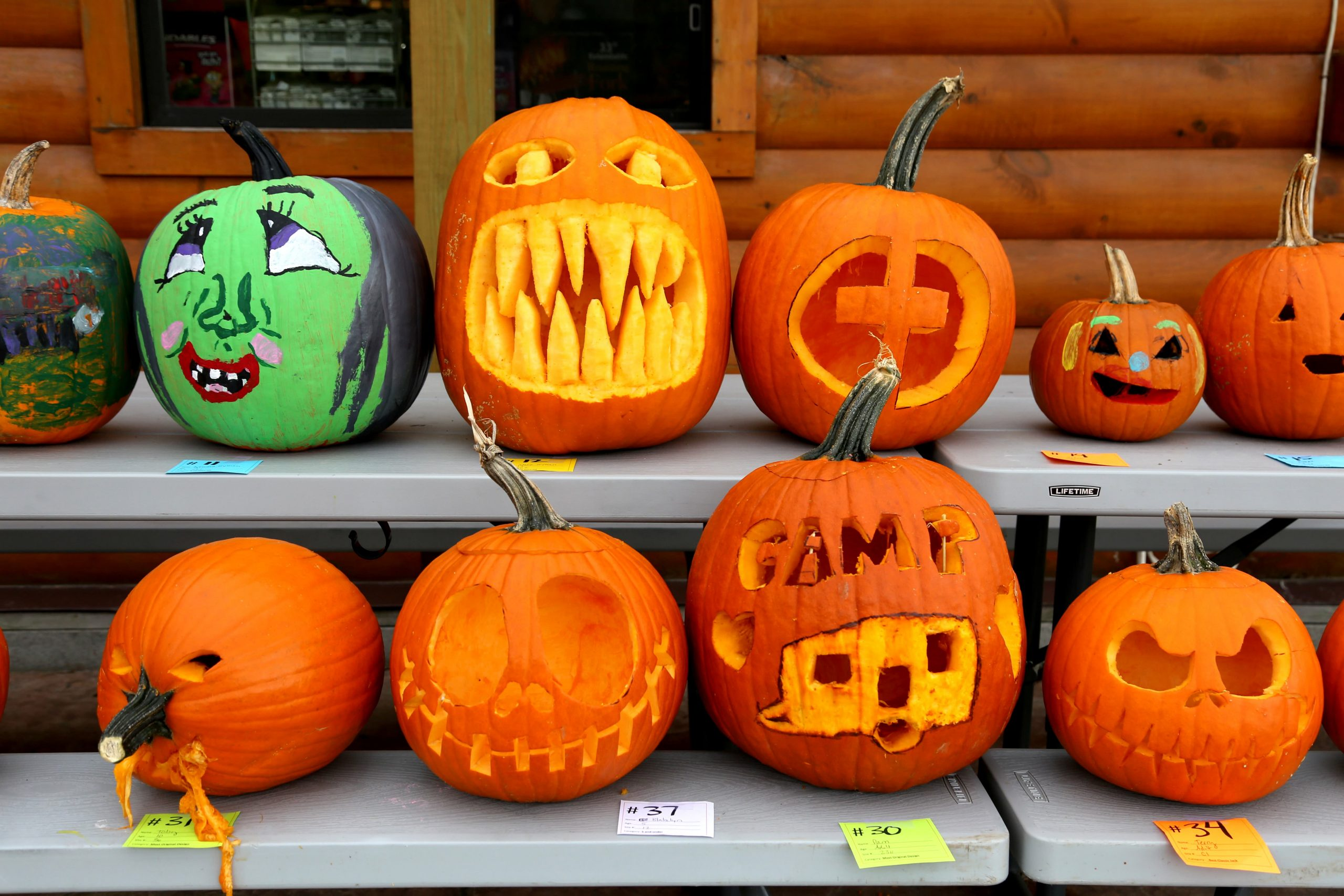 carved pumpkins sitting on a picnic table