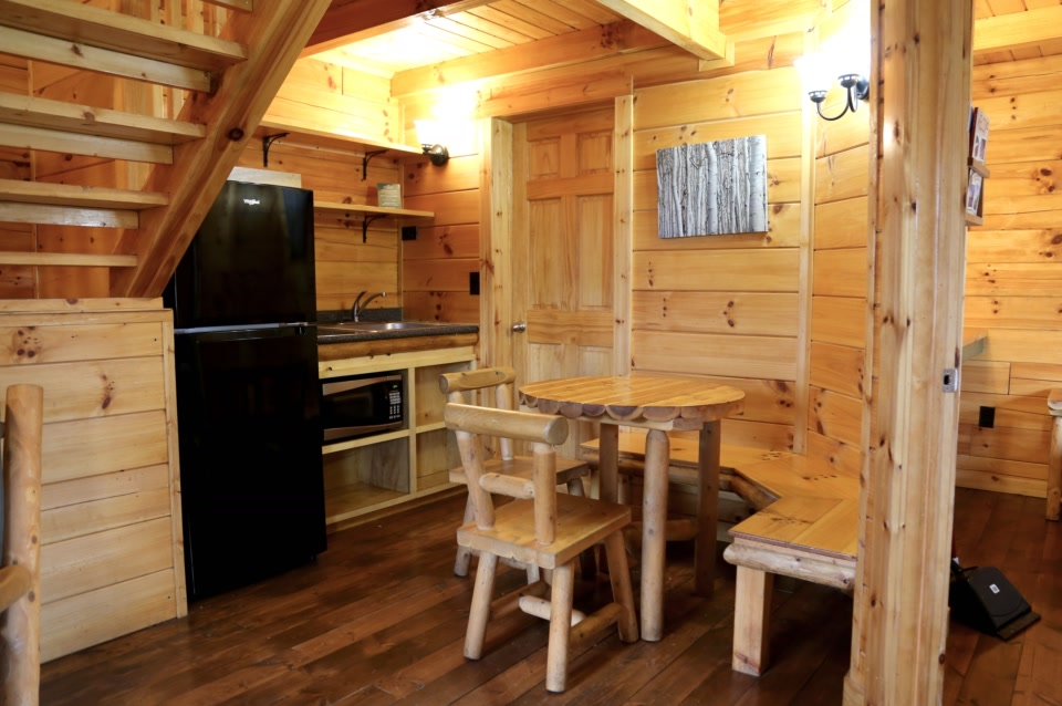 deluxe plus cabin kitchenette with table and chairs
