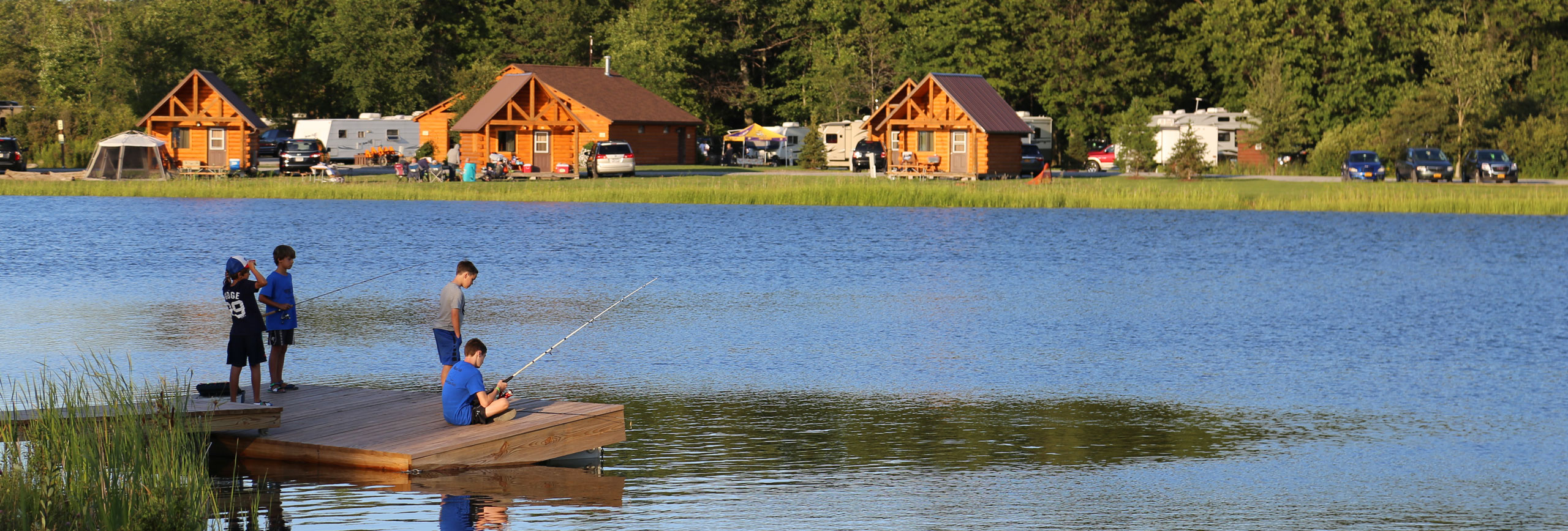 children fishing on the lake at Branches of Niagara campground