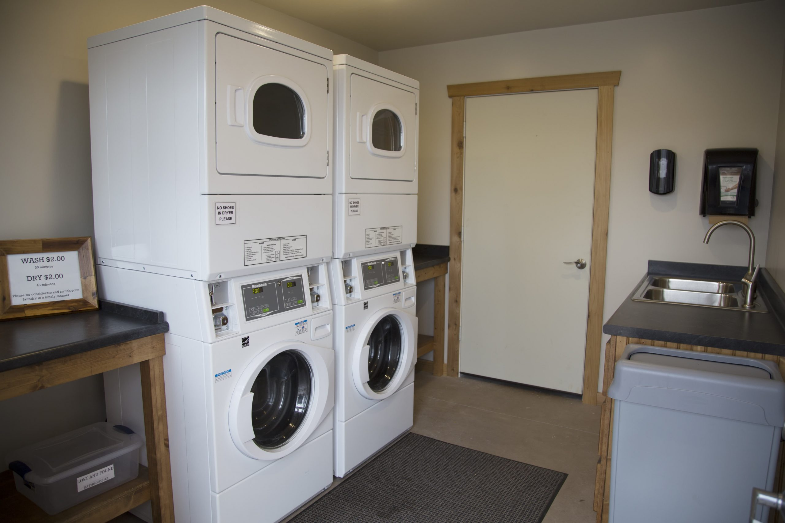laundry room with stacked washer and dryer