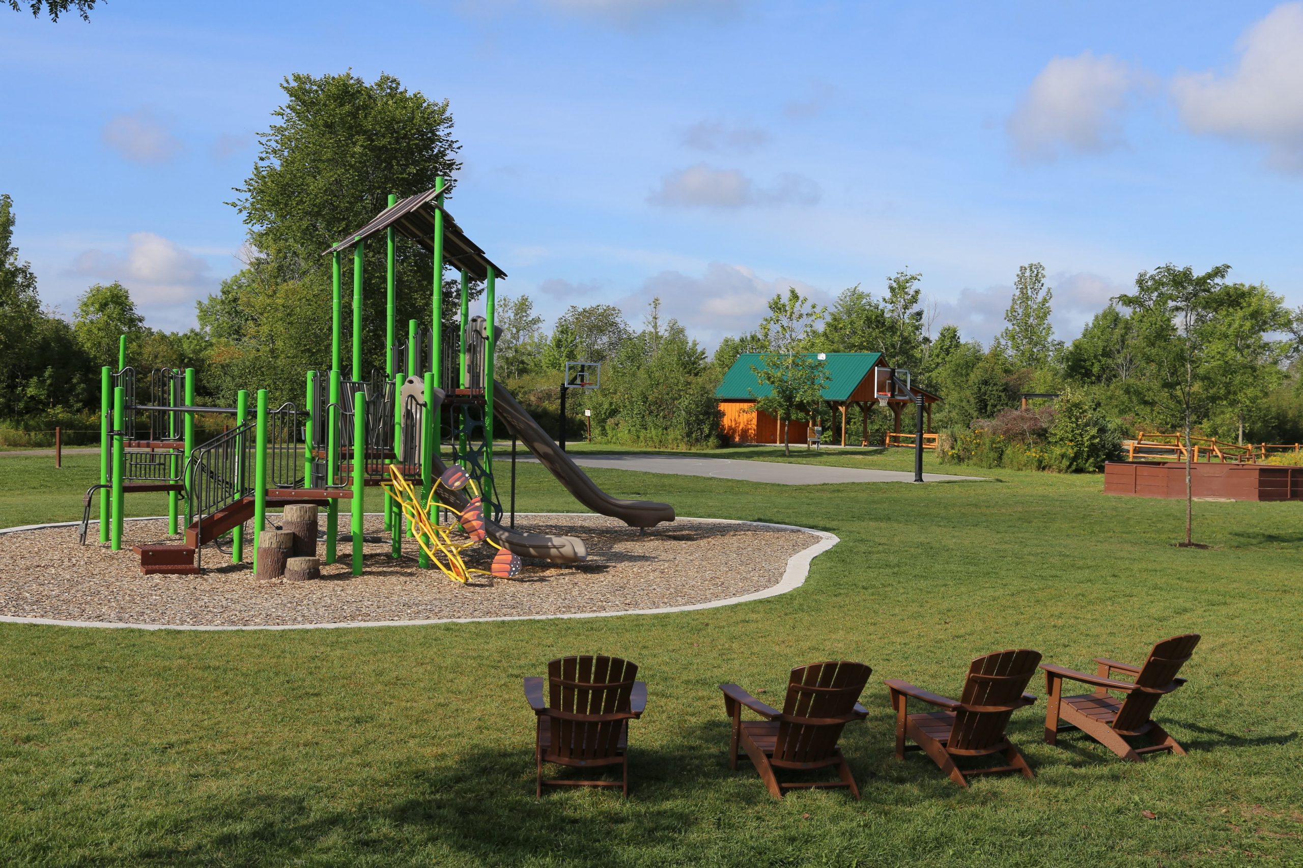 playground structure and Adirondack chairs