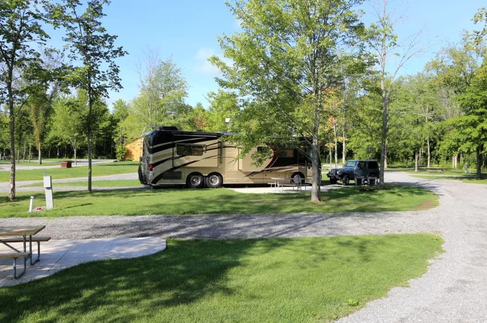 Motorhome parked on pull thru site