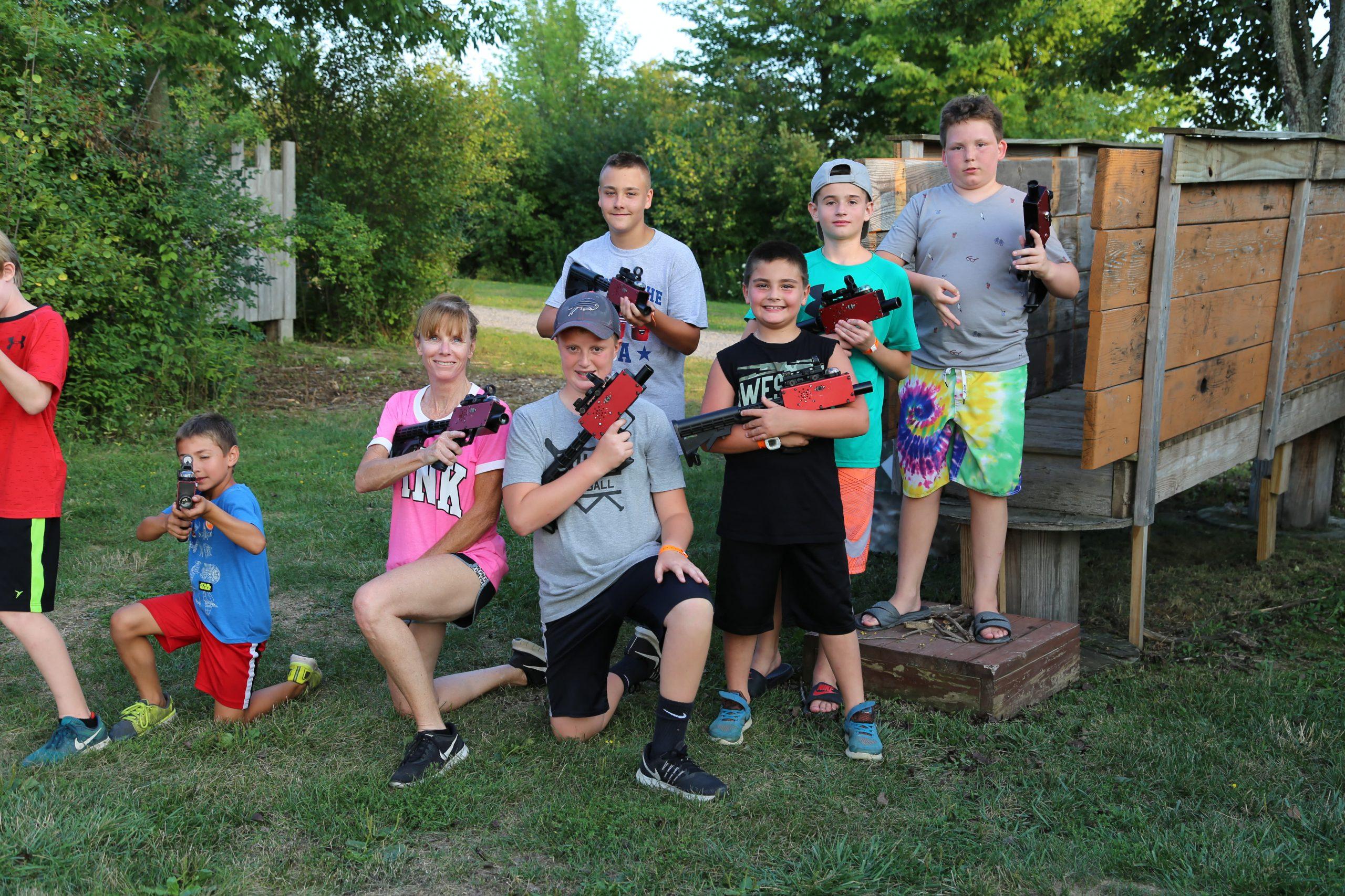 team of kids playing laser tag