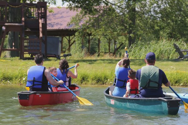 people in canoes